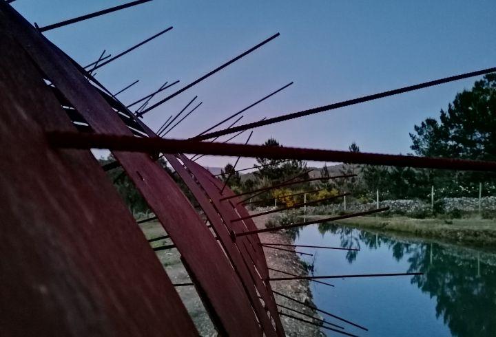 Lago e escultura da Quinta